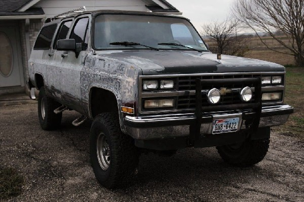 1990 Chevrolet Suburban being stripped for painting